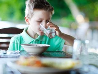 Boy drinks water.