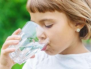 Girl drinks purified water